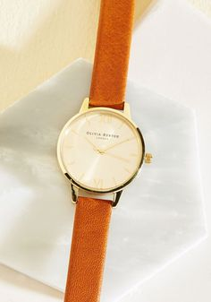Float on a cloud of stylish enchantment as you daydream wearing this leather Midi Dial watch from Olivia Burton! A charming accompaniment to your everyday ensembles, this chestnut-hued timepiece showcases metallic numerals atop its gold face, looking lovely as you muse under a sunny sky.
