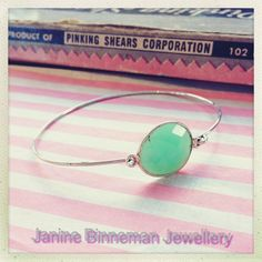 Silver bangle with a Green Chalcedony gemstone