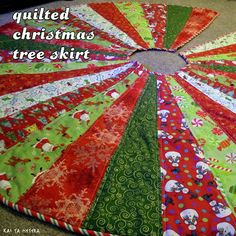 quilted christmas tree skirt. I can imagine this in so many beautiful color combinations to make your decor of the house really pop!