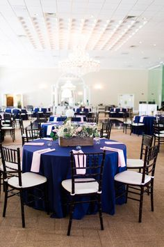 Preppy reception decor idea - round tables with navy blue linens, pink napkins + floral centerpieces {Amber Rhodes Photography}