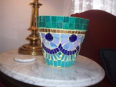 Teal, blue and gold mosaic planter Completed 3-25-14 by Donna Waller