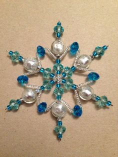 Pretty Homemade Snowflake Ornaments :: Best home design ideas Christmas Ornaments To Make, Snowflake Ornaments, Christmas Snowflakes, Beaded Ornaments, Christmas Jewelry, Xmas Crafts, Christmas Projects, Christmas Decorations, Beaded Snowflake