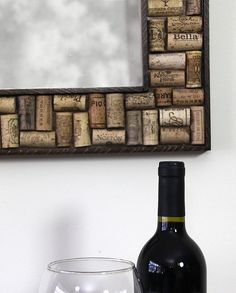 Mirror made with recycled wine bottle corks, framed with walnut trim. This mirror is built of birch plywood onto which the wine corks are artistically arranged and glued in place. The corks are cut in half to give ample gluing surface for a permanent bond.  This mirror is for the wine lover and will compliment your wine cellar, dining room or kitchen or any place where you and your guests enjoy a glass of cab or pinot.  The corks are cut so the vintners insignia is readable, and there are…