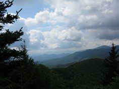 In the shadow of Mount Mitchell, this 5.6-mile ridgeline hike climbs through hemlock and chestnut oak to a watchtower overlook of Blue Ridge and Pisgah peaks.