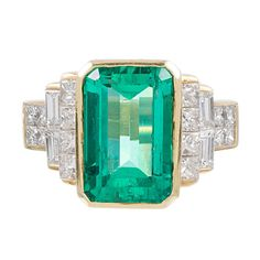 7.00 Carat Emerald and Diamond Ring | From a unique collection of vintage cluster rings at http://www.1stdibs.com/jewelry/rings/cluster-rings/