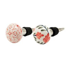 Preserve your wine in style with ceramic floral bottle stoppers. The secure rubber ring ensures a secure fit while the artful ceramic adds a decorative touch to any bottle. Includes two painted ceramic stoppers in two different prints. Ceramic s. Buy Wine Online, Wine Bottle Stoppers, Wine Fridge, Wine And Spirits, Luxury Home Decor, Gift For Lover, Home Decor Accessories, Cottage, Ceramics