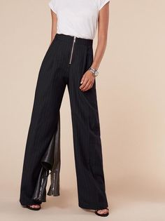 When you want something fancier than jeans. This is a wide leg trouser with an exposed. center front zipper.
