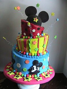Mickey mouse - Topsy turvey made for a first birthday using buttercream with fondant accents. Mickey Mouse Hat is  made from fondant. First time trying FBCT making mickey, minnie, donald, and goofy for sides of bottom tier.  Thanks for looking!