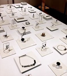 Liisa Hashimoto. Look at all of the different handmade earring displays.