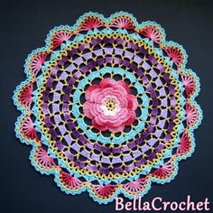 Crochet Roses Crochet Rose Mandala Free Pattern - You will love our post that includes a lovely DIY Crochet Mandala Rug. You will find lots of artistic crochet mandala rugs and free patterns too. Crochet Mandala Pattern, Crochet Flower Patterns, Crochet Squares, Crochet Flowers, Crochet Doilies, Granny Squares, Scarf Patterns, Crochet Home, Diy Crochet