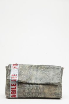 Taping Clutch Grey. http://www.greycomma.com/collections/minor-term/products/taping-clutch-grey