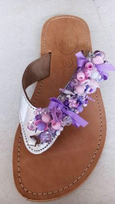 Handmade leather sandals designed by Elli lyraraki