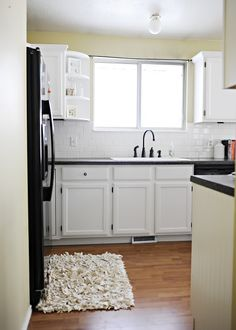 white cabinets, black appliances, bead board, sage green paint...basically, everything.