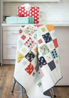 Lissa Alexander: This contemporary white quilt is just a hop, skip, and a jump away when you use pre-cut and squares. Video quilting tutorial available! Look for Happy Happy! Quilting Tutorials, Quilting Projects, Quilting Designs, Quilting Ideas, Quilting 101, Quilt Design, Sewing Projects, Charm Pack Quilts, Charm Quilt