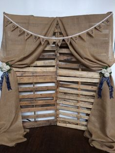 country burlap and wooden palette wedding photo booth backdrop / http://www.himisspuff.com/rustic-wood-pallet-wedding-ideas/3/