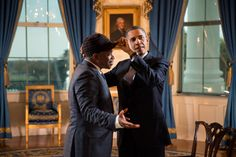 The President adjusts Sway Calloway's hat following an interview for a Live MTV special, in the Blue Room of the White House, Oct. 26, 2012.