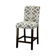 This counter stool instills a sense of refreshing elegance in your dining space, designed with lush cushioned upholstery that rolls gracefully at the backrest and descends to a sturdy flared base. Handcrafted and finished for maximum style in your choice of chic pattern fabrics.