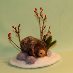Winter Hedgehog in a Log-needle felted scene. 24.00, via Etsy.