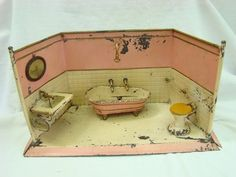 Antique CA 1920 Göso Goso Germany Litho Tin Doll House Large Dolls Bathroom   This toy is made in lithographed heavy tin. This bathroom contains one mirror, one sink, one bathtub, soap dish, towel rails and the toilet. The interesting part of this wonderful toy is that it has a water holder system, that you can fill in and the water runs through pipes!.