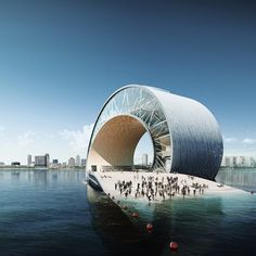 "Designed by Mesh Architects in collaboration with BIG, the ""Wave Pier"" features a dynamic, twisting form that swoops up effortlessly out of the water and curves back gracefully like a trained dolphin or roller coaster."