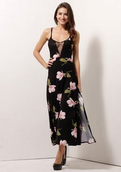 This side-slit floral long dress is sophistication at its finest. It features fun and flirty floral prints perfect for the spring and summer. This partially lined and stretchable frock is also designed with a thigh-high slit at the skirt's side as well as a crisscross strap design at the back for a seductive touch.