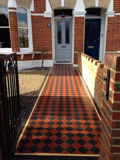 black and red victorian tile path with yellow and black line border