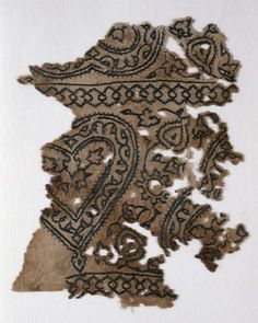 a textile fragment decorated with blue silk hearts, from Egypt, Mamluk Period (1250-1517)