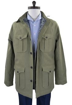 Luxire safari coat constructed in Linen Cotton Canvas: Olive: http://custom.luxire.com/products/gov-olive-canvas-54002_105  Consists of 2 chest pockets and 2 hip pockets, 6 button closure and standard shirt collar.  Lining: Olive paisley Print: http://custom.luxire.com/products/olive-paisley-prints-on-black