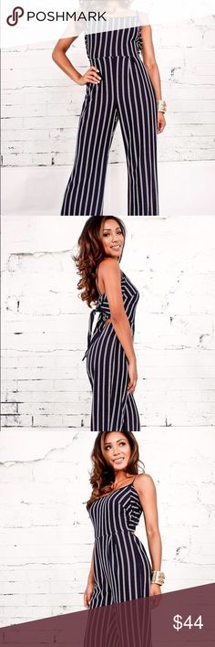 Navy Striped Tie Back Jumpsuit This jumpsuit features a multi stripe print, round neckline with thin straps, sleeveless, cutout back with a tie strap with scroungy material going across which is perfect for a strapless bra. Jumpsuit measures bust measures about 14 inches, and the length measure about 56 inches.    Content: -95% Polyester -5% Spandex  Size: MODEL INFO: HEIGHT 5ft 4in | WAIST: 24in | HIPS: 35in | CHEST 34C WEAR Size:Medium Pants Jumpsuits & Rompers