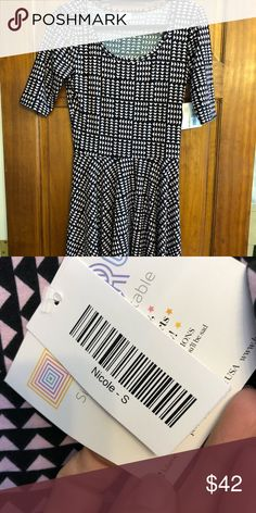 52eafd56ba575 LuLaroe Nicole Dress Brand New with Tags! Black and pink pattern.