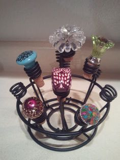 Wine stoppers made with old corks and knobs.