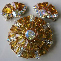 A Juliana glass and rhinestone brooch and earrings set.