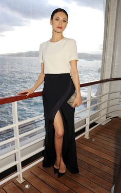 While aboard a yacht in Antibes, France, Olga Kurylenko was part sexy, part sophisticated in a white silk t...