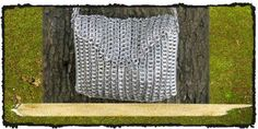 joan of arc chain mail purse  made by a womens artisan co-op in brasil!  one of our favorite ways 2 recycle!  hundreds of soda pop pull tab tops  + crochet create a georgeous sustainable bag -