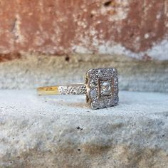 Antique Vintage Art Deco 0.30 Diamond Engagement Ring in 14k Gold This is a beautiful Art Deco period engagement or fashion ring with lovely design of 14k gold. The center diamond measures about 3.3 mm, weighing 0.14 carats; VS/G or so quality. It is prong-set into a white gold square illusion with milgrain border detailing. There are 16 accent diamonds in the square and down the shoulders. One of the most popular antique designs we sell in the shop. These usually have sapphires so its f...