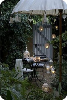 These dripping lights are incredibly romantic. Love those small places in gardens