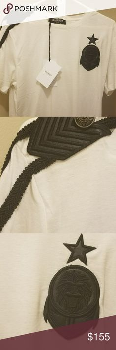 BALMAIN SHIRT AUTHENTIC Beautiful white and black shirt with pagon black lion emblem . The shirt is a 2xl in European size but fits smaller for US size . This size is rare these shirts are usually small to XL . Balmain Shirts Tees - Short Sleeve