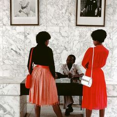 Two women at the British consulate in Kampala, Uganda. 1984. . Chris Steele-Perkins