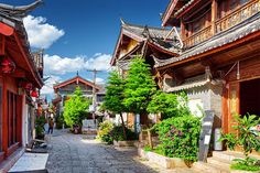A scenic street in the Old Town of Lijiang. One of China's most picturesque destinations and aptly called the 'Venice of the Orient', this town of quaint cobblestone streets and canals arched with graceful bridges amid blooming gardens has been around since the 1300s.