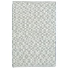 Test drive this rug in your space.Order a swatch by adding it to your cart.This eco-friendly indoor/outdoor rug, featuring a diamond pattern in soft blue and ivory, adds subtle graphic appeal to rooms throughout the home. Mix and match with our  Swedish Stripe indoor/outdoor rug.