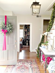 Mini Christmas Tour (via Bloglovin.com ) Love the foyer lantern and other touches in this home