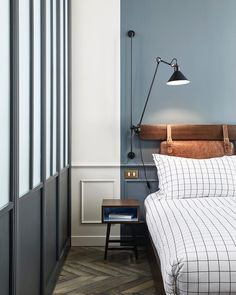 How Paris's Newest Hotels Are Redefining French Design Modern bedroom decor inspiration. Hoxton Hotel in Paris guestroom with unique two-tone wall of slate grey and white, leather headboard, and herringbone flooring. Grey Bedroom With Pop Of Color, Two Tone Walls, Hotel Paris, Paris Hotels, Hotel 6, Paris City, Leather Headboard, Custom Headboard, Hotel Room Design