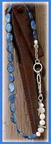 Wonderful Day Necklace... IN THE MIX Smooth Kyanite ovals in a pearlized silvery blue luster accompanied by textured sterling silver rings and Pearls with accents of Artisan crafted silver beads, charm & hook closure.  SIZING IT UP Necklace length........17.75 inches  Matching earrings available