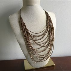 Brown Bead Necklace Adjustable length. Metal changing color but hidden behind neck. Lots of jewelry listed- BUNDLE for a discount!! No trades. New York & Company Jewelry Necklaces