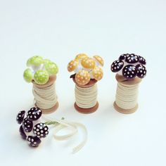 Patch NYC: wood spool metallic ribbon with mushroom ornaments