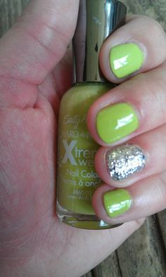 Lime green nails with silver glitter accent nail