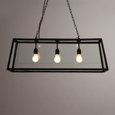 Crafted of clear glass panes set in a black iron frame, our exclusive pendant lamp is a dramatic, three-dimensional statement piece ideal for the dining room or any large space. >> #WorldMarket Home Decor, Lighting