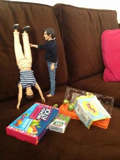 Harry is impressed by Louis' handstand. | 17 One Direction Dolls Who Came Alive At Night