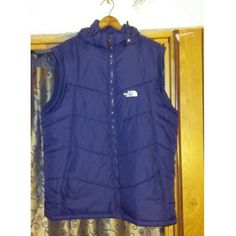 The North Face Puffer Vest Navy blue with white lettering. Two zipper pockets on each side. With detachable hood. The North Face Jackets & Coats Vests