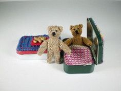 """Pocket Ted is only 8 cm / 3"""" tall and sleeps in his own knitted bed in a tin. He has pipe cleaners in his arms and legs so he can sit up and he and his bed are knitted with small amounts of 4 ply yarn."""